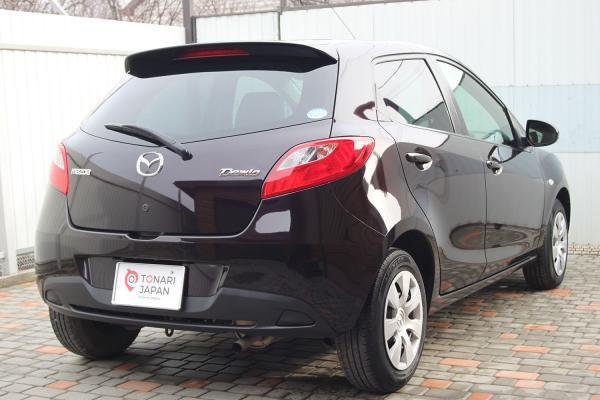 Mazda Demio 2015 коричневый сзади