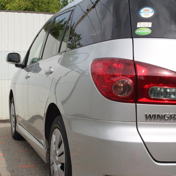 Nissan Wingroad серый фара