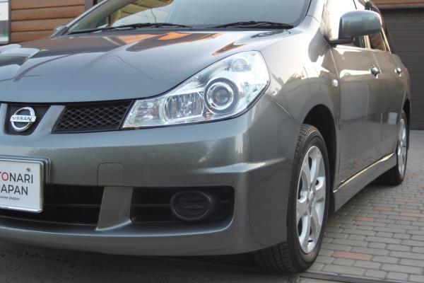 Nissan Wingroad 2015 серый передний бампер