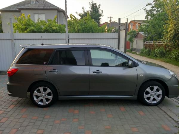 Nissan Wingroad 2015 серый вид сбоку