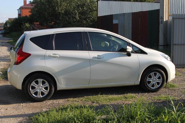 Nissan Note белый сбоку